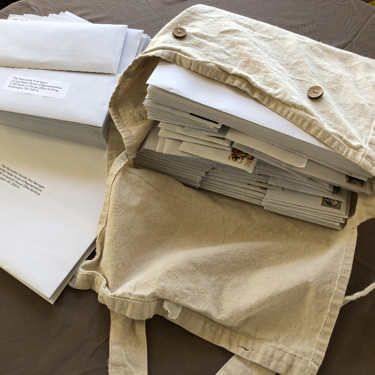 Photograph of Mail Bag Filled with Envelopes